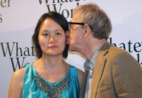 Woody Allen and his wife, Soon Yi. who is also his adopted daughter.